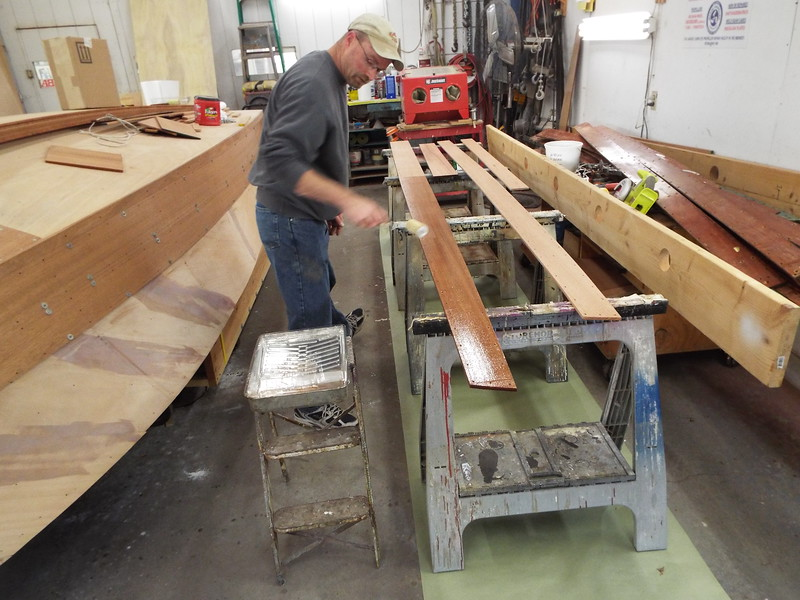 Epoxy being applied to the back side of the new plank before being attached to the hull.