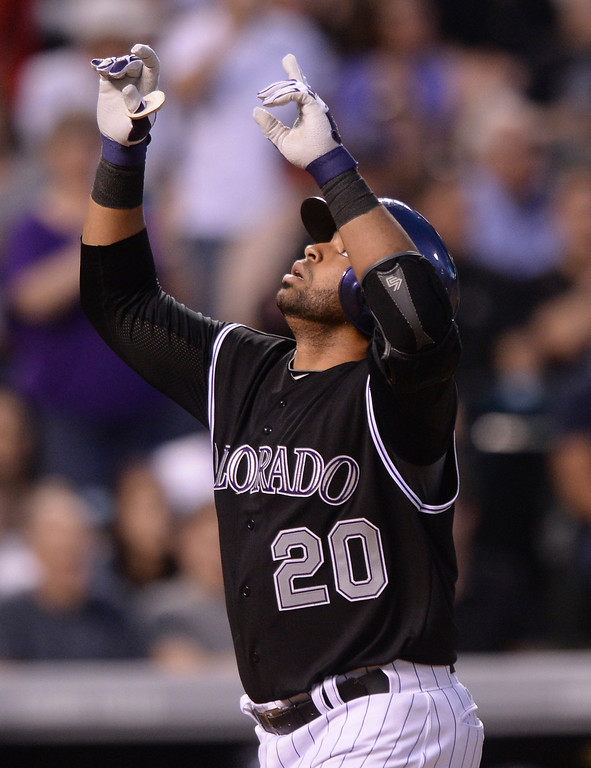 . Colorado catcher Wilin Rosario crossed the plate after homering in the fourth inning. The Colorado Rockies hosted the Atlanta Braves Tuesday night, June 10, 2014. (Photo by Karl Gehring/The Denver Post)
