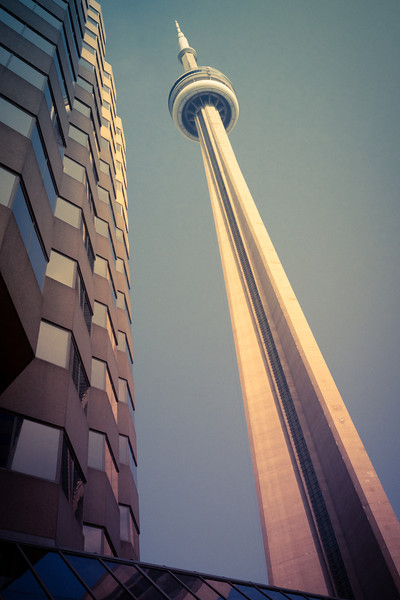Toronto's CN tower  When it's construction was finished in 1976 it was the largest standing structure. It servers as a communication and observation tower. There is also a great restaurant at the top that gives you an amazing view of the city.  From the photo blog of http://alikgriffin.com
