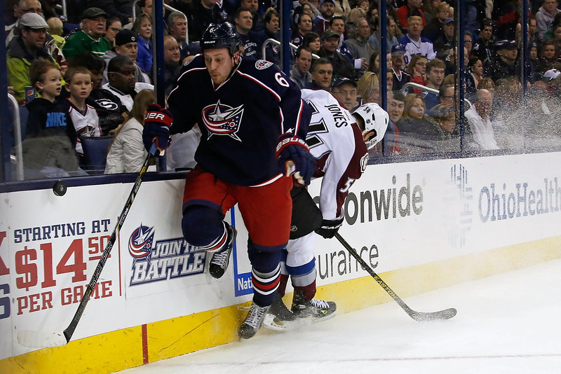 . Nikita Nikitin #6 of the Columbus Blue Jackets and David Jones #54 of the Colorado Avalanche collide while chasing after a loose puck during the first period on March 3, 2013 at Nationwide Arena in Columbus, Ohio. (Photo by Kirk Irwin/Getty Images)