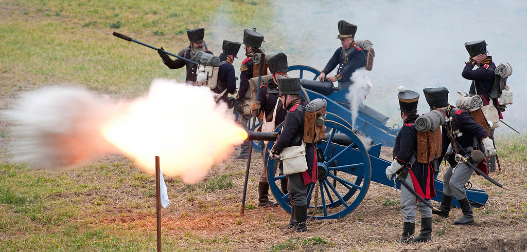 . Troops are shooting with cannons during the reconstruction of the Battle of the Nations at the 200th anniversary near Leipzig, central Germany, Sunday, Oct. 20, 2013. (AP Photo/Jens Meyer)