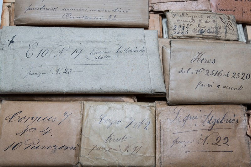 Original envelopes filled with punches.