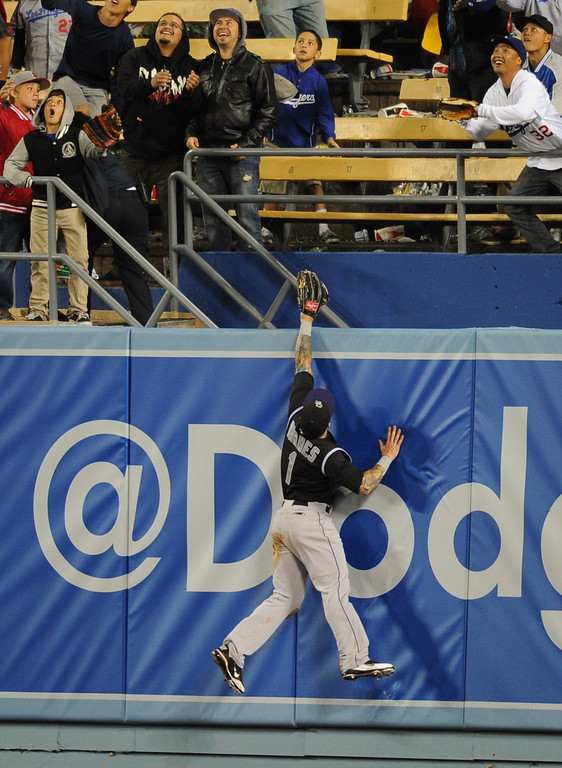 . Rockies right fielder Brandon Barnes can\'t catch a two-run homer by the Dodgers\' Adrian Gonzalez in the 11th inning, Friday, April 25, 2014, at Dodger Stadium. (Photo by Michael Owen Baker/L.A. Daily News)