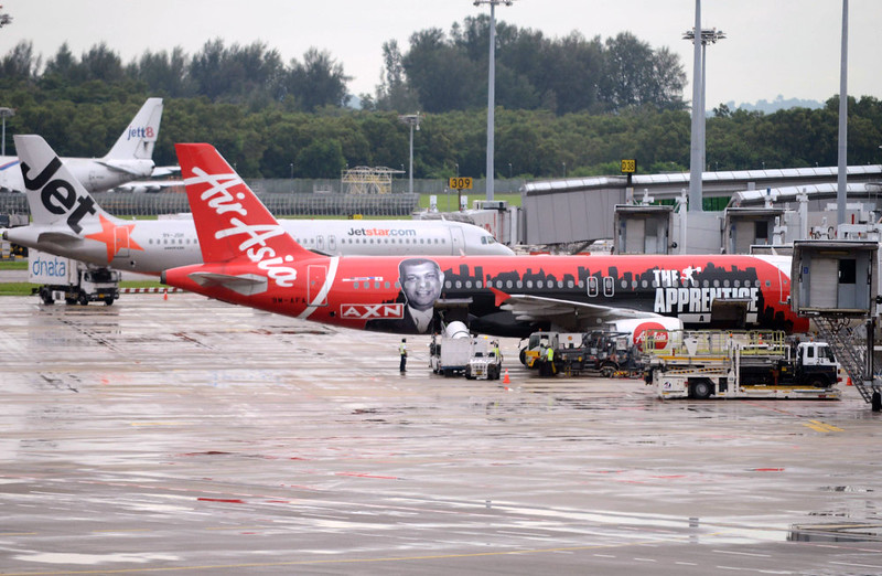 . An AirAsia plane is parked on the tarmac at terminal 1 at Changi international airport in Singapore on December 29, 2014. Shares in AirAsia, Southeast Asia\'s biggest budget airline, lost more than seven percent in morning trading on December 29 in Kuala Lumpur after one of its jets, AirAsia flight QZ8501, disappeared on December 28 with 162 people on board. MOHD FYROL/AFP/Getty Images