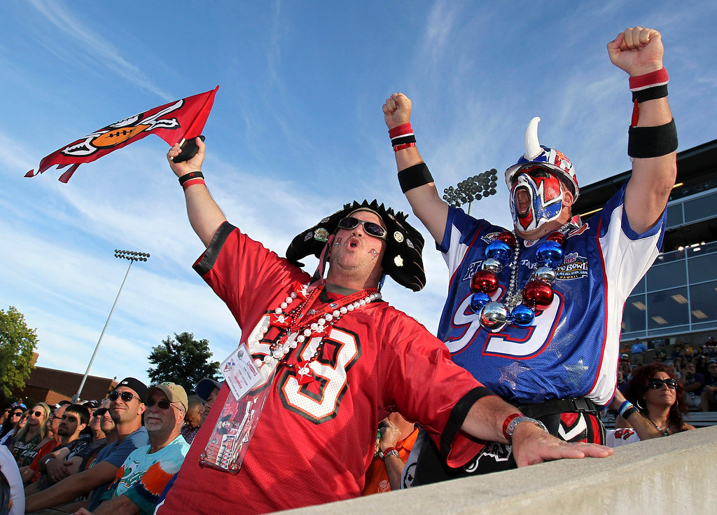 . NFL fans show up in full attire to cheer this years class of inductees to the NFL Pro Footbal Hall of Fame in Canton, Ohio August 3, 2013. REUTERS/Aaron Josefczk