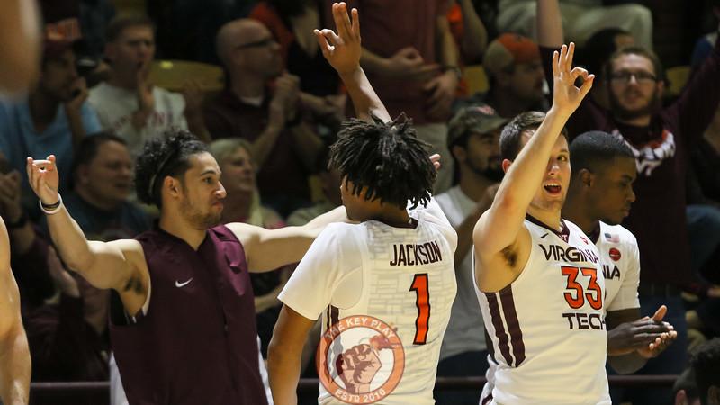 Devin Wilson, Tyrie Jackson, and Matt Galloway celebrate a Virginia Tech three point shot. (Mark Umansky/TheKeyPlay.com)