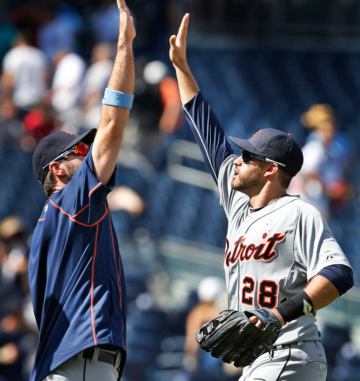 . Detroit Tigers pitcher Justin Verlander, left, celebrates with Detroit Tigers right fielder J.D. Martinez (28) after the Tigers 12-4 victory over the New York Yankees in a baseball game at Yankee Stadium in New York, Sunday, June 21, 2015.  Martinez was responsible for six of the Tigers 12 runs. (AP Photo/Kathy Willens)