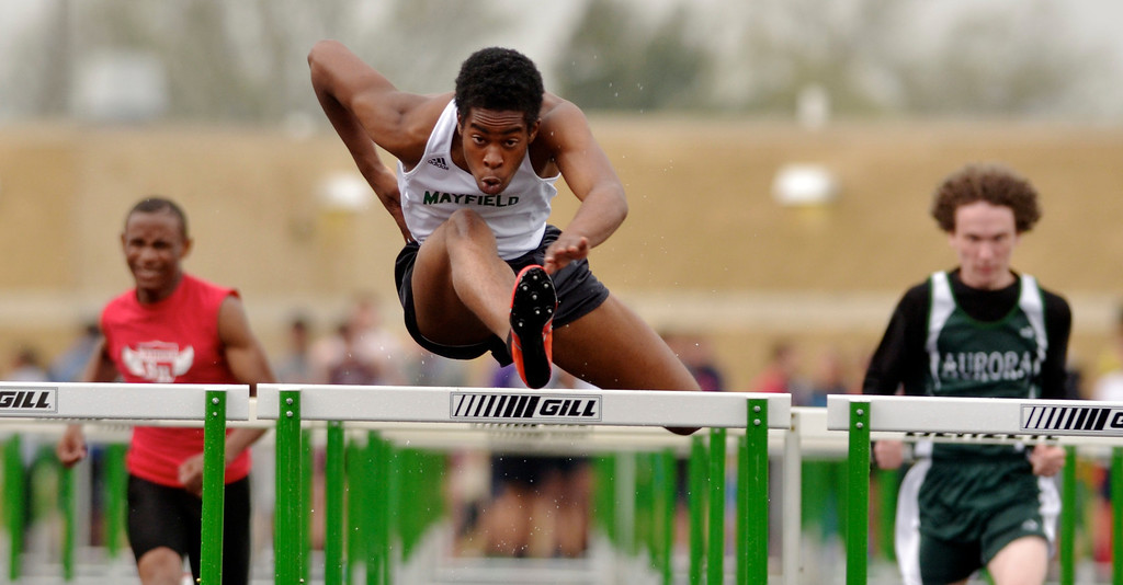 . Jeff Forman/JForman@News-Herald.com Artrice Gordon, Mayfield, competes in a preliminary flight of the 100 meter hurdles during the Mayfield 2014 Track and Field Invitaional May 9 at Mayfield High School.