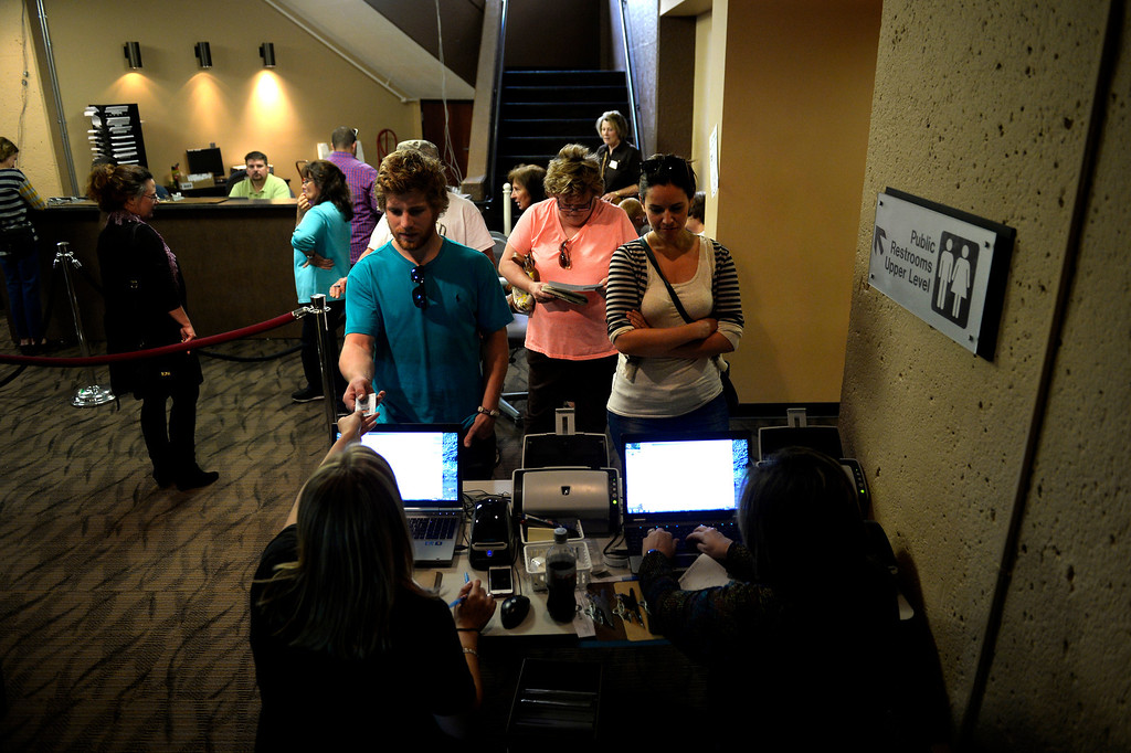 . COLORADO SPRINGS, CO. - September 10: Cody Horn hands over his identification for registering during the recall vote for Senate President John Morse at the Centennial Building in downtown September 10, 2013 Colorado Springs, Colorado. (Photo By Joe Amon/The Denver Post)