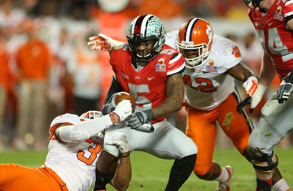 . MIAMI GARDENS, FL - JANUARY 03: Braxton Miller #5 of the Ohio State Buckeyes is sacked in the second quarter by Vic Beasley #3 and Stephone Anthony #42 of the Clemson Tigers during the Discover Orange Bowl at Sun Life Stadium on January 3, 2014 in Miami Gardens, Florida.  (Photo by Mike Ehrmann/Getty Images)