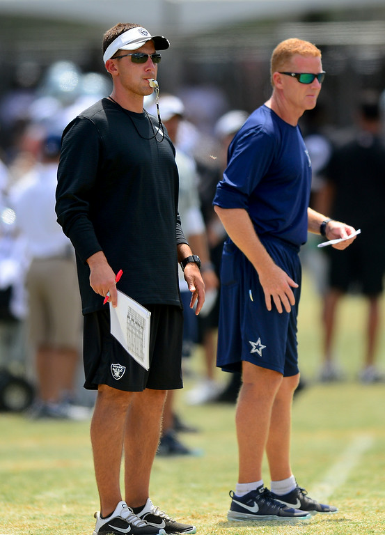 . Raiders head coach Dennis Allen, left, and Cowboy head coach Jason Garrett watch the Cowboys-Raiders practice in Oxnard, Wednesday, August 13, 2014. (Photo by Michael Owen Baker/Los Angeles Daily News)