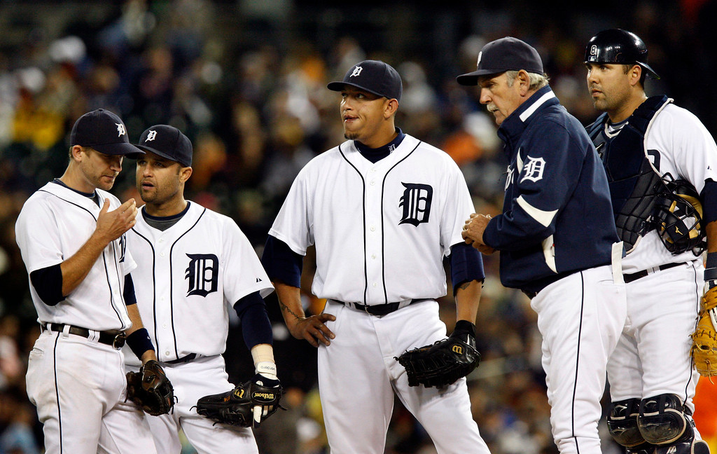 . Detroit Tigers from left, Adam Everett, Placido Polanco, Miguel Cabrera, Jim Leyland and Gerald Laird wait on the mound for pitcher Armando Galarraga during the second inning of a baseball game against the Chicago White Sox in Detroit, Saturday, Oct. 3, 2009. The pitching change was the second during the second inning. (AP Photo/Carlos Osorio)