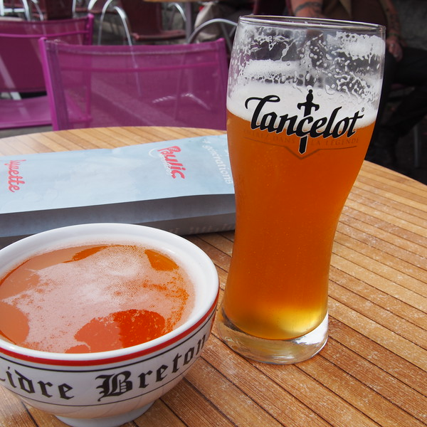 small cup of Brittany cider and a glass of Lancelot beer.