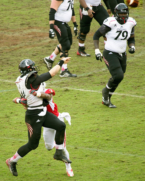 Kay gets the ball away just as Jackson is bringing him down.