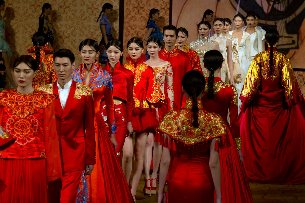 . Models parade the latest fashion from NE Tiger during the opening show for the China Fashion Week in Beijing Saturday, Oct. 25, 2014. Held twice annually, the Fashion Week showcases the latest from both domestic and foreign designers. (AP Photo/Ng Han Guan)