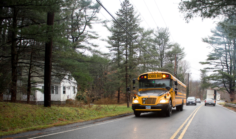 Description of . A school bus drives on December 18, 2012 in Newtown, Connecticut. Students in Newtown, excluding Sandy Hook Elementary School, return to school for the first time since last Friday's shooting at Sandy Hook which took the live of 20 students and 6 adults.  DON EMMERT/AFP/Getty Images