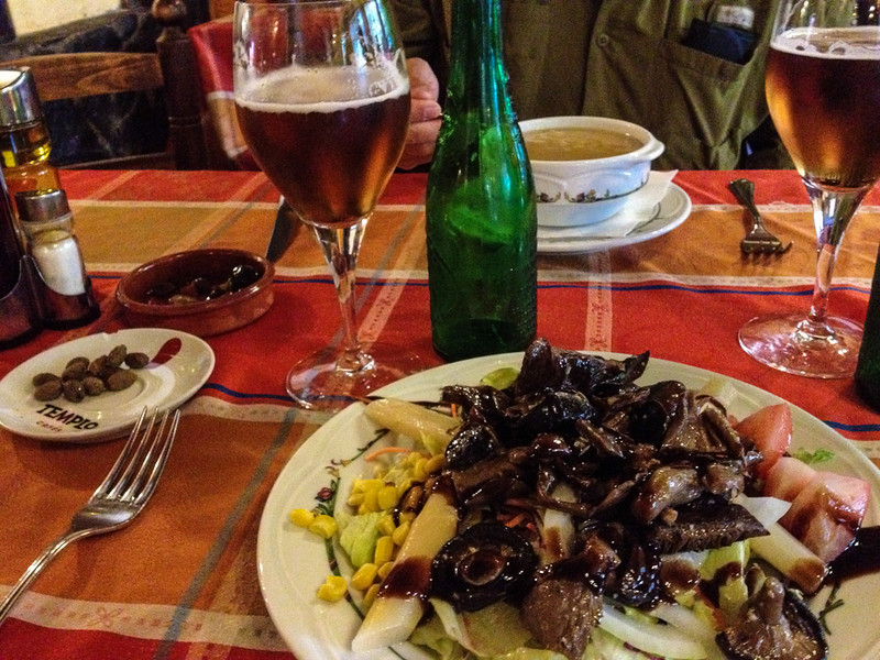 Olives and local beer accompany our starters of beef-noodle soup and wild mushroom salad.
