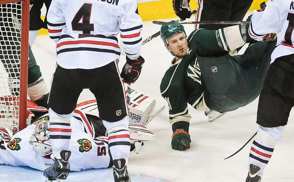 . Minnesota center Kyle Brodziak drops to the ice after missing a chance to score in the third period against the Blackhawks. (Pioneer Press: Ben Garvin)