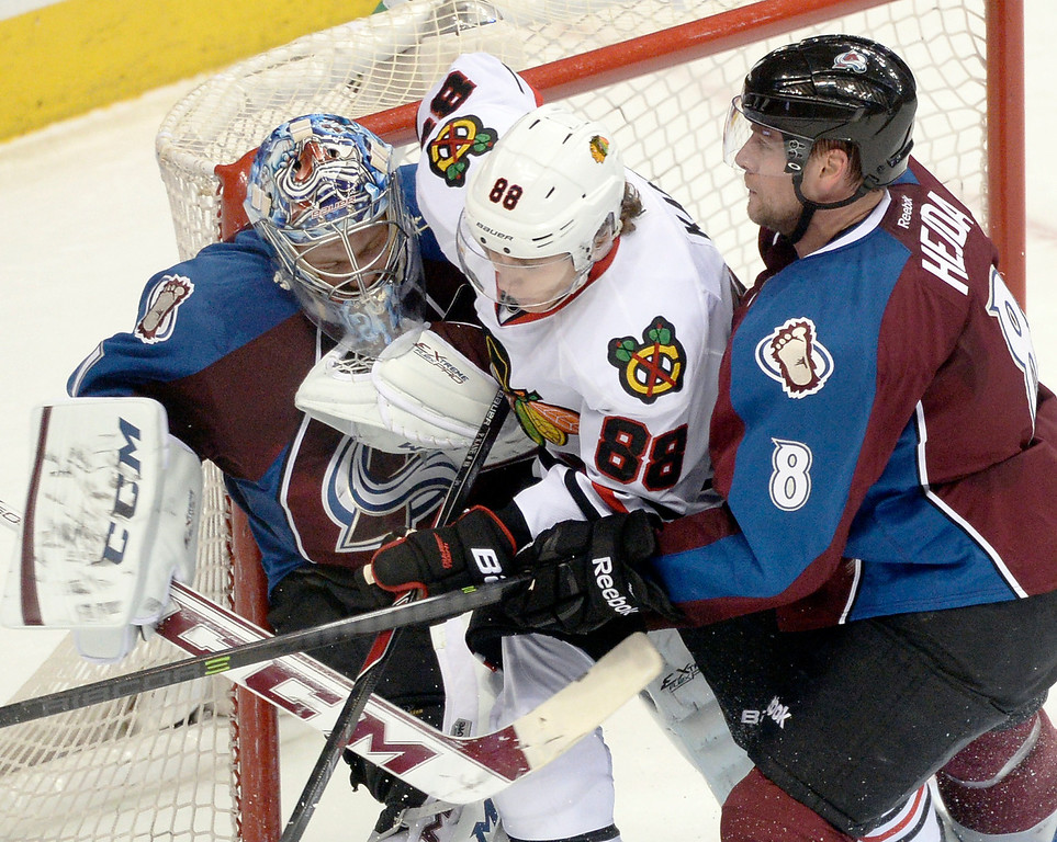 . Chicago wing Patrick Kane (88) was sandwiched between Colorado goalie Semyon Varlamov and defenseman Jan Hejda in the second period.  (Photo by Karl Gehring/The Denver Post)
