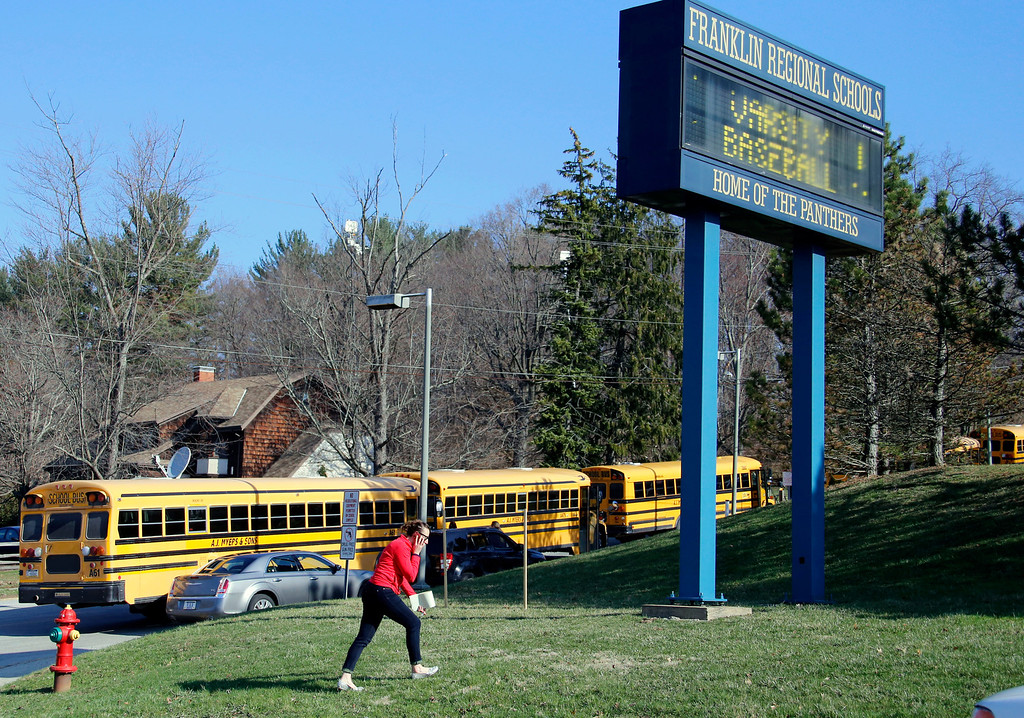 . A woman walks onto the campus of the Franklin Regional School District where several people were stabbed at Franklin Regional High School on Wednesday, April 9, 2014, in Murrysville, Pa., near Pittsburgh. The suspect, a male student, was taken into custody and being questioned. (AP Photo/Gene Puskar)