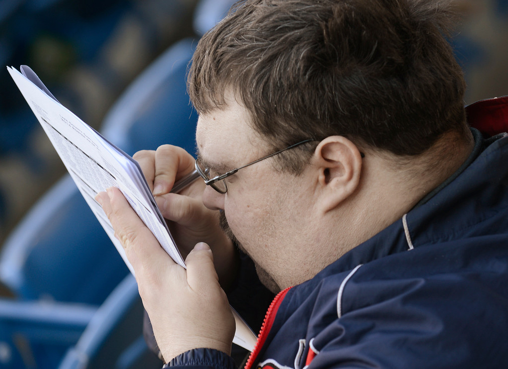 . Maribeth Joeright/MJoeright@News-Herald.com<p> An enthusiastic baseball fan concentrates as he keeps score during an exhibition game between the Lake County Captains and the Akron Rubberducks.
