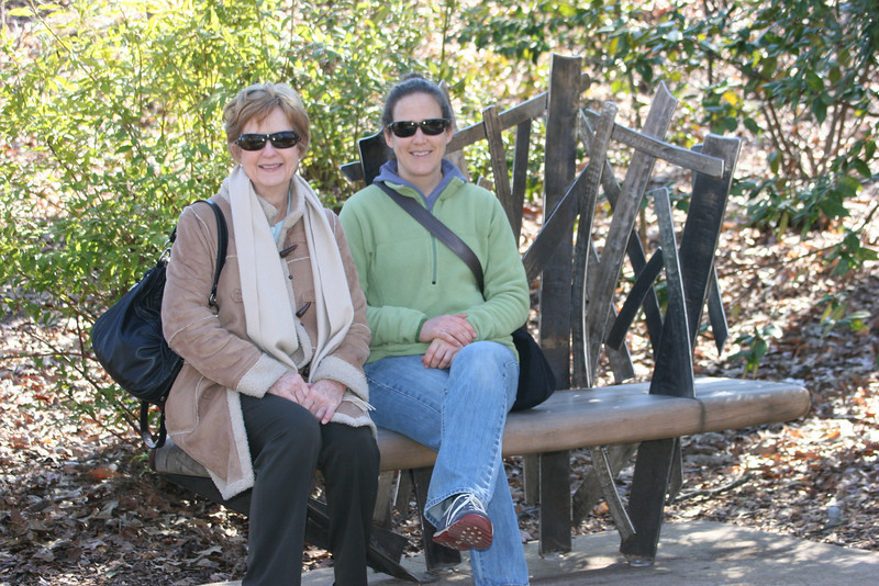 Chee and Anne on an artwork bench