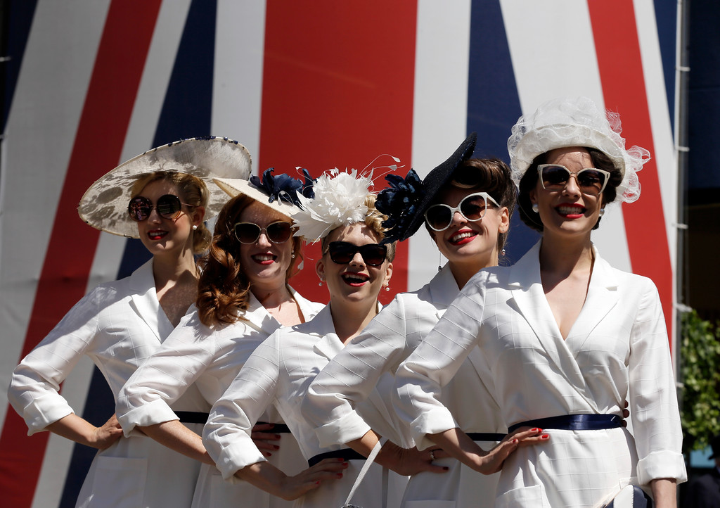 . The Tootsie Rollers pose for the media on the third day of the Royal Ascot horse race meeting, which is traditionally known as Ladies Day, in Ascot, England Thursday, June 21, 2018. (AP Photo/Tim Ireland)