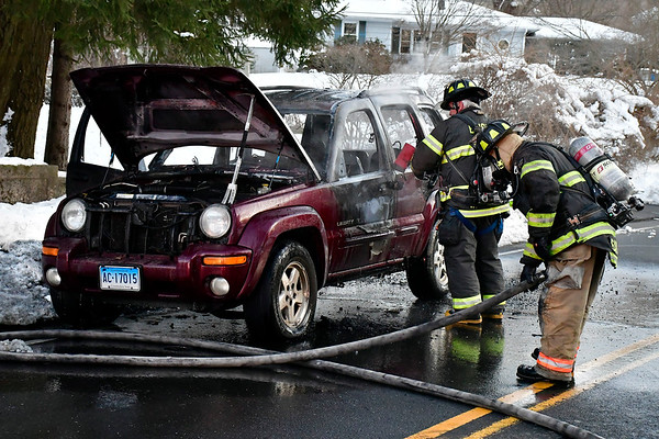 3/5/2019 Mike Orazzi | Staff Bristol firefighters extinguish a Jeep Liberty that caught fire on Peck Lane in Bristol Tuesday afternoon.