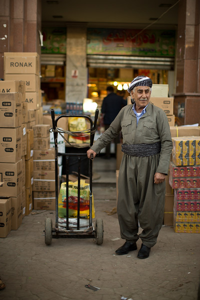 A Kurdish man in traditional clothes in Erbil Souq, Iraqi Kurdistan.