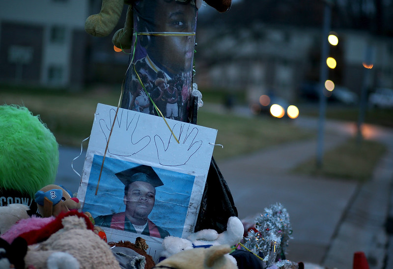 . A photo of 18-year-old Michael Brown sits on a memorial on November 22, 2014 in Ferguson, Missouri. Tensions in Ferguson remain high as a grand jury is expected to decide this month if Ferguson police officer Darren Wilson should be charged in the shooting death of Michael Brown.  (Photo by Justin Sullivan/Getty Images)
