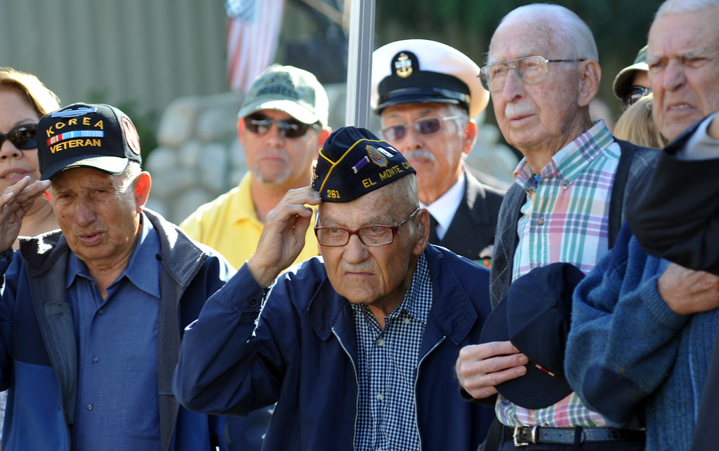 . Veteran Russ McFann, center, as the National Anthem is played during the Veterans Day Celebration at El Monte City Hall on Monday November 11, 2013. Veterans are honored with speeches and music and a flag ceremony. (San Gabriel Valley Tribune/Staff Photo by Keith Durflinger)