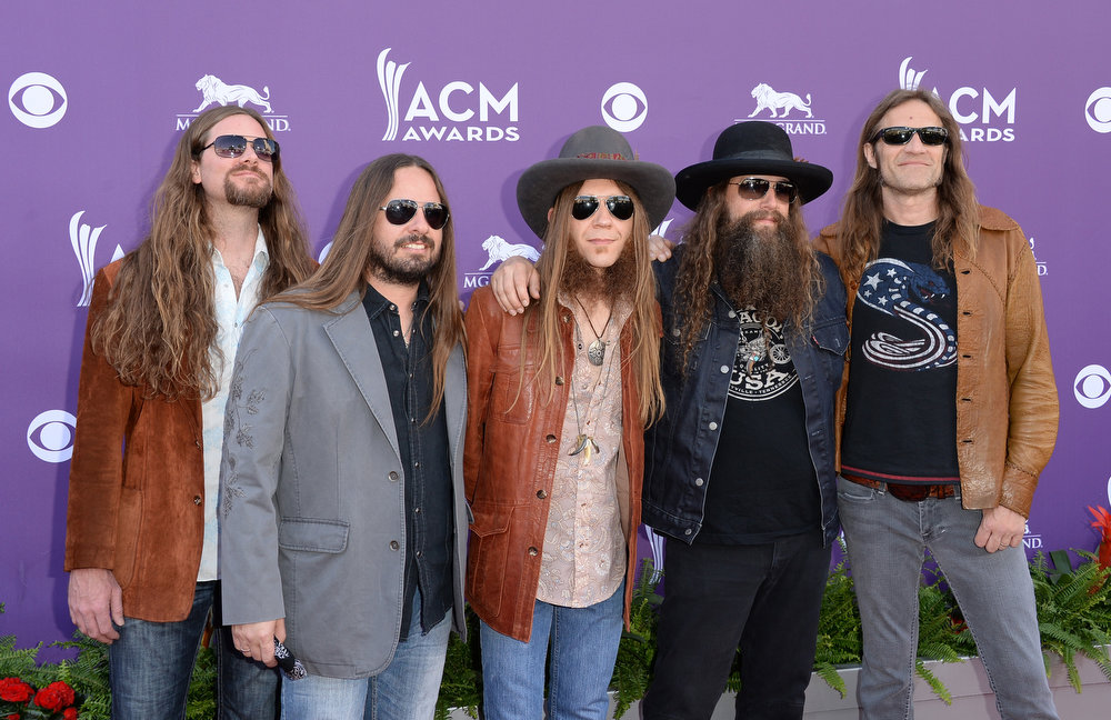 . (L-R) Brandon Still, Paul Jackson, Charlie Starr, Brit Turner, and Richard Turner of music group Blackberry Smoke arrive at the 48th Annual Academy of Country Music Awards at the MGM Grand Garden Arena on April 7, 2013 in Las Vegas, Nevada.  (Photo by Jason Merritt/Getty Images)