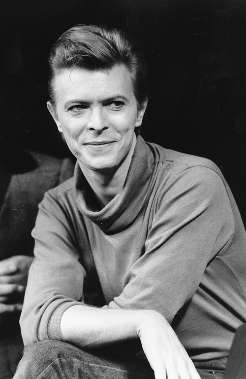 ". FILE i In this Sept. 17, 1980, file photo, David Bowie listens during a news conference after a rehearsal at the Booth Theater in New York.  Bowie was appearing in the Broadway production of ""The Elephant Man.\"" Bowie, the innovative and iconic singer whose illustrious career lasted five decades, died Monday, Jan. 11, 2016, after battling cancer for 18 months. He was 69. (AP Photo/Marty Lederhandler, FIle)"