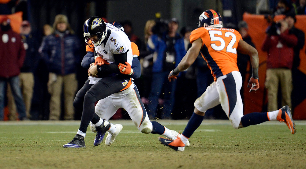 . Denver Broncos outside linebacker Von Miller (58) wraps up Baltimore Ravens quarterback Joe Flacco (5) during the second half.  The Denver Broncos vs Baltimore Ravens AFC Divisional playoff game at Sports Authority Field Saturday January 12, 2013. (Photo by John Leyba,/The Denver Post)