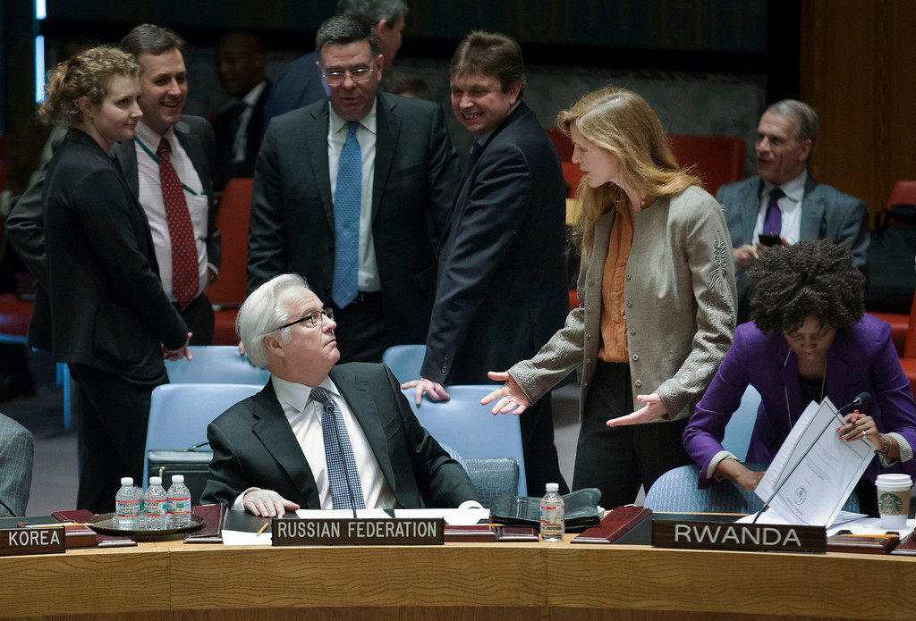 . Russia\'s U.N. Ambassador Vitaly Churkin, left, and United Statesí U.N. Ambassador Samantha Power interact before an U.N. Security Council meeting on the Ukraine crisis, Saturday, March 15, 2014, at the United Nations headquarters. Russia vetoed a U.N. resolution declaring Sunday\'s referendum on the future of Ukraine\'s Crimean Peninsula illegal, but its close ally China abstained in a show of Moscow\'s isolation. Supporters of the U.S.-sponsored resolution knew that Russia would use its veto, but they put the resolution to a vote Saturday morning to show the strength of opposition to Moscow\'s takeover of Crimea. (AP Photo/John Minchillo)