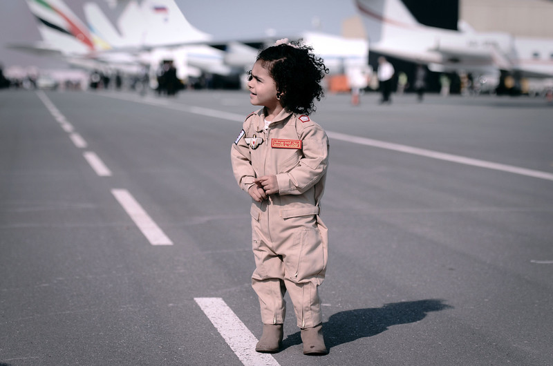 . A Bahraini girl wearing a pilot\'s outfit attends the opening of the Bahrain International Airshow 2014, in Sakhir, south of the capital Manama, on January 16, 2014. (MOHAMMED AL-SHAIKH/AFP/Getty Images)