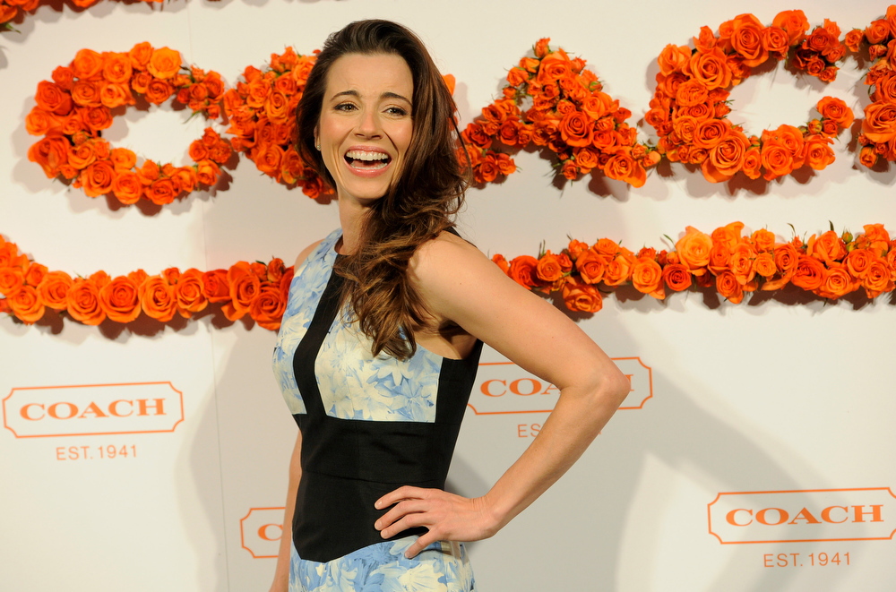 . Actress Linda Cardellini reacts to photographers at the 3rd Annual Coach Evening to Benefit Children\'s Defense Fun at Bad Robot on Wednesday, April 10, 2013 in Santa Monica, Calif. (Photo by Chris Pizzello/Invision/AP)