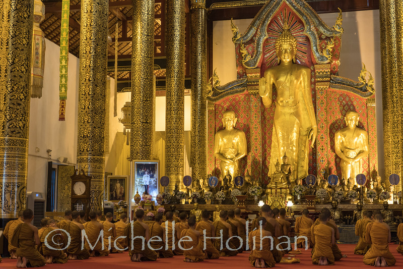 CHIANG MAI, THAILAND - DECEMBER 28, 2018: Unidentified Buddhist monks observe evening prayers at Wat Chedi Luang.