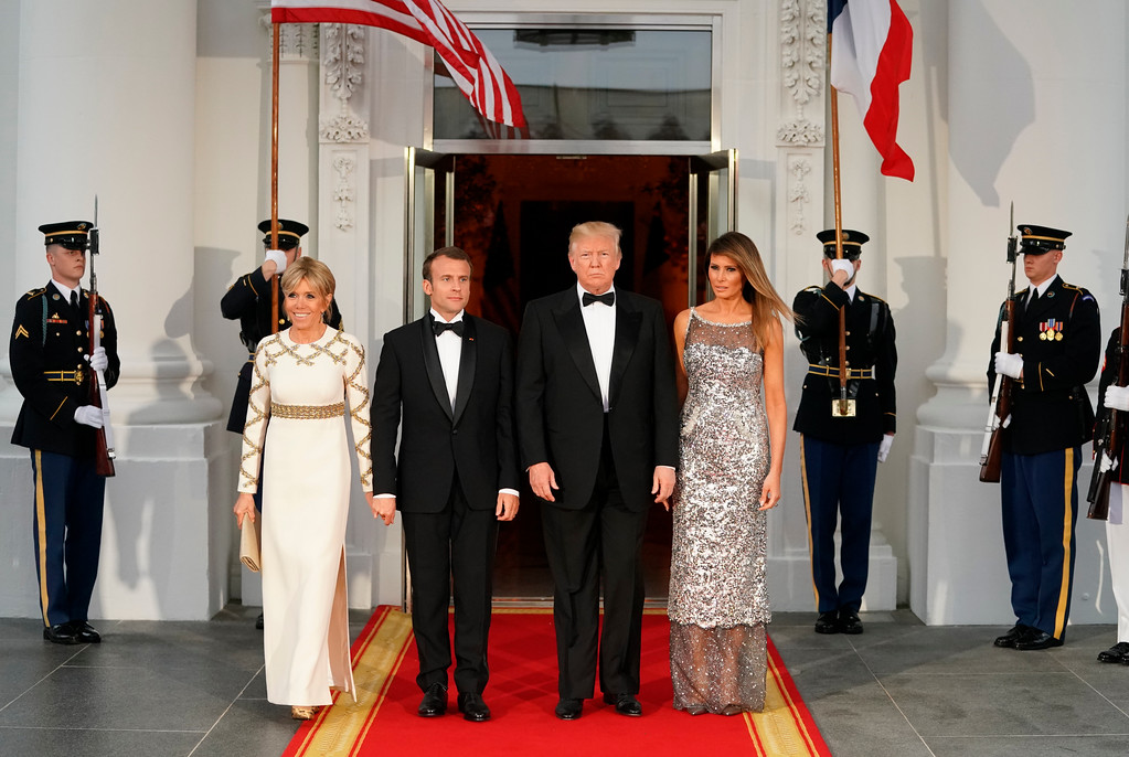 . President Donald Trump accompanied by first lady Melania Trump pose for a photo after greeting French President Emmanuel Macron and his wife Brigitte Macron as they arrive for a State Dinner at the White House in Washington, Tuesday, April 24, 2018. (AP Photo/Andrew Harnik)