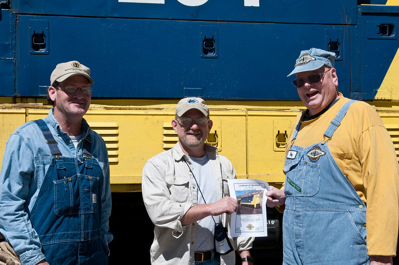 I receive my diesel certificate from Nevada Northern engineer Ray Moser and fireman Dan Shurtleff.