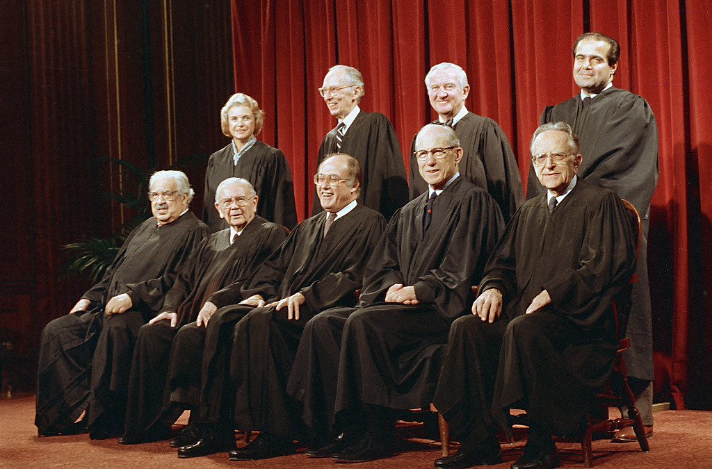 . Members of the U.S. Supreme Court pose for a formal group portrait in Washington, Nov. 12, 1986.  Front row, from left are:  Thurgood Marshall; William Brennan, Jr.; Chief Justice William Rehnquist; Byron White; and Harry Blackmun.  From left in back row:  Sandra Day O\'Connor; Lewis Powell, Jr.; John Paul Stevens; and Antonin Scalia.  (AP Photo/Bob Daugherty)