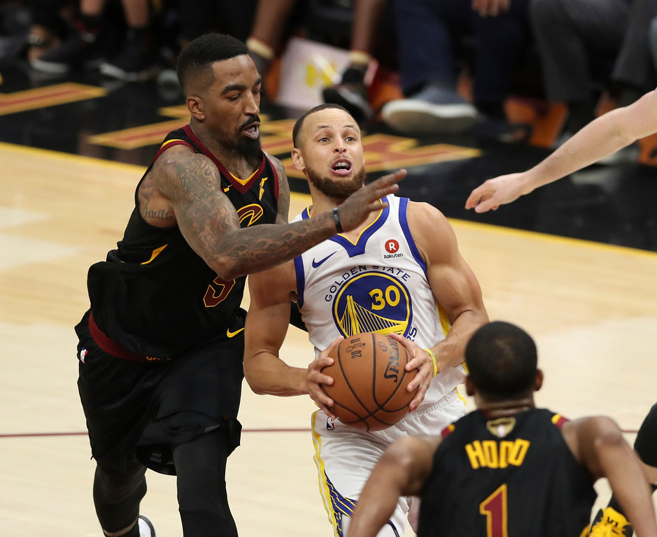 . Golden State Warriors\' Stephen Curry is defended by Cleveland Cavaliers\' JR Smith in the second half of Game 3 of basketball\'s NBA Finals, Wednesday, June 6, 2018, in Cleveland. The Warriors defeated the Cavaliers 110-102 to take a 3-0 lead in the series. (AP Photo/Carlos Osorio)