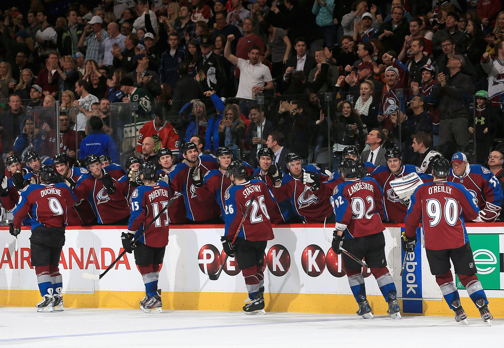 . DENVER, CO - MARCH 08:  The Colorado Avalanche celebrate a goal by Ryan O\'Reilly #90 of the Colorado Avalanche against the Chicago Blackhawks to give the Avalanche a 4-1 lead in the second period at the Pepsi Center on March 8, 2013 in Denver, Colorado.  (Photo by Doug Pensinger/Getty Images)