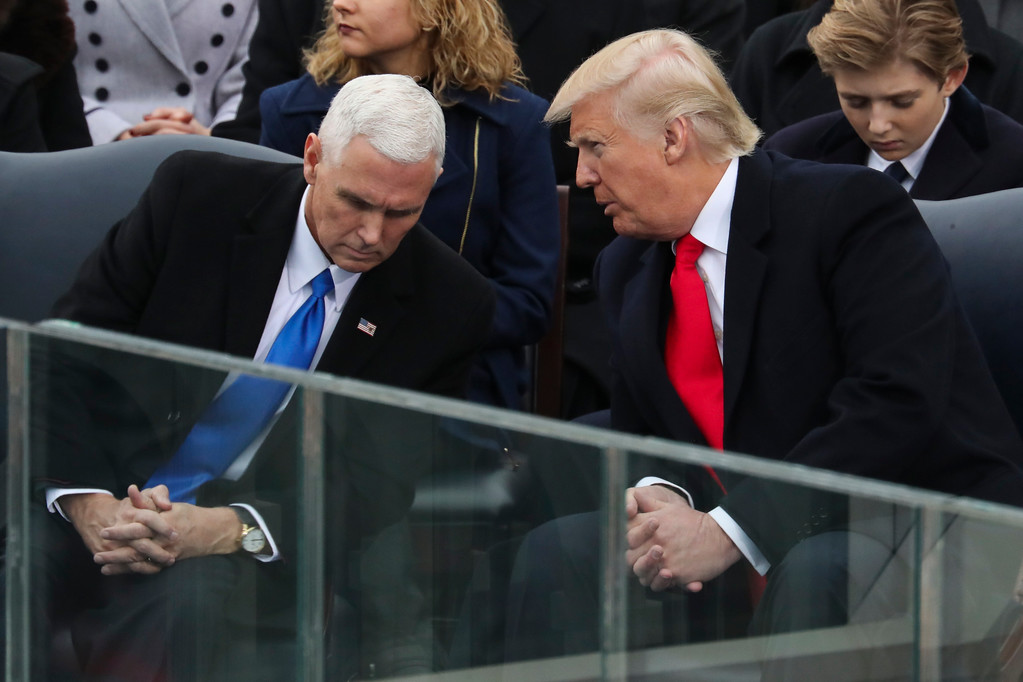 . President-elect Donald Trump leans over to talk with Vice President-elect Mike Pence during the 58th Presidential Inauguration at the U.S. Capitol in Washington, Friday, Jan. 20, 2017. (AP Photo/Andrew Harnik)