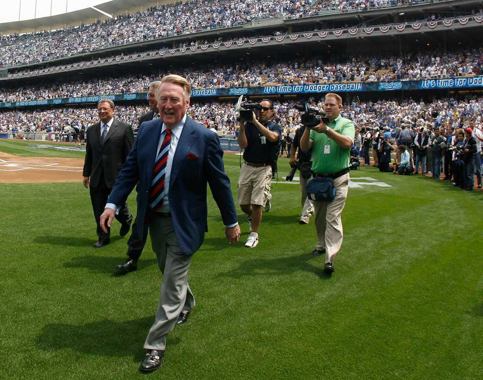 . Hall of Famer Vin Scully walks off after tossing out the first pitch before the home opener between the San Francisco Giants and the Los Angeles Dodgers at Dodger Stadium on Monday April 13, 2009 in Los Angeles. (SGVN/Staff Photo by Keith Birmingham/SPORTS)