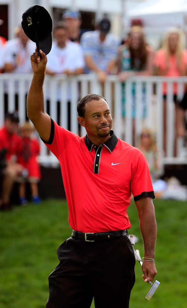 . Tiger Woods waves to the crowd on the 18th green after winning the World Golf Championships-Bridgestone Invitational  during the Final Round at Firestone Country Club South Course on August 4, 2013 in Akron, Ohio.  (Photo by Sam Greenwood/Getty Images)