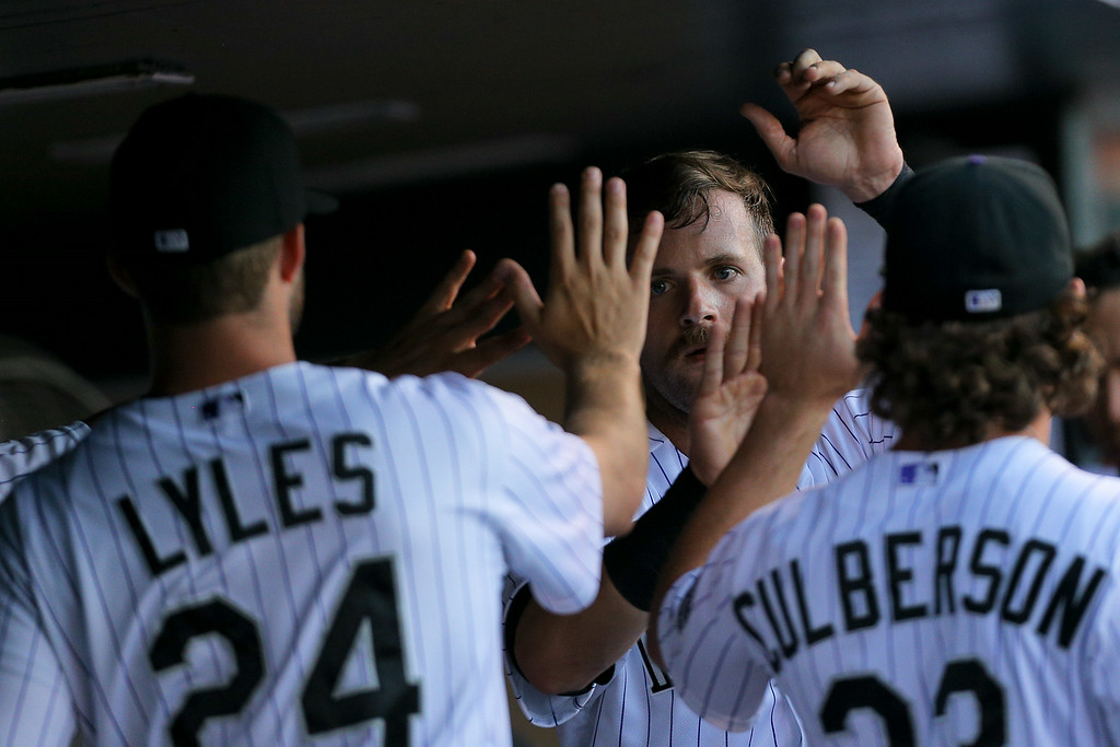 . DENVER, CO - JULY 22:  Ben Paulsen #4 of the Colorado Rockies celebrates in the dugout after scoring during the second inning against the Washington Nationals at Coors Field on July 22, 2014 in Denver, Colorado.  (Photo by Justin Edmonds/Getty Images)