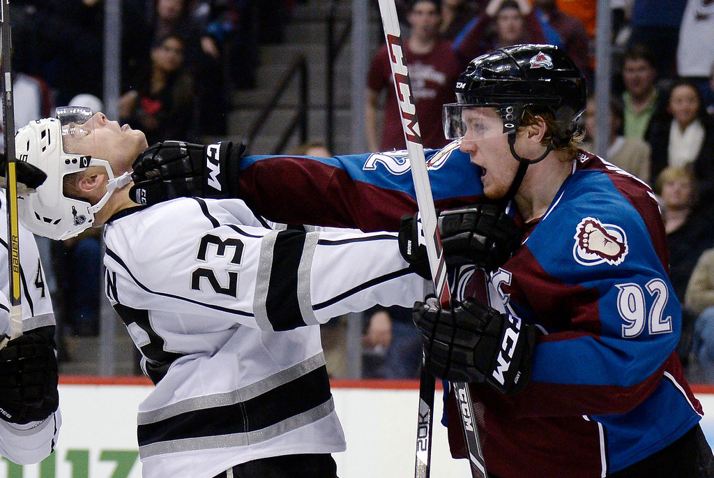 . DENVER, CO - FEBRUARY 27: Los Angeles Kings right wing Dustin Brown (23) gets a face full of Colorado Avalanche left wing Gabriel Landeskog (92) glove during the third period February 27, 2014 at Pepsi Center. (Photo by John Leyba/The Denver Post)
