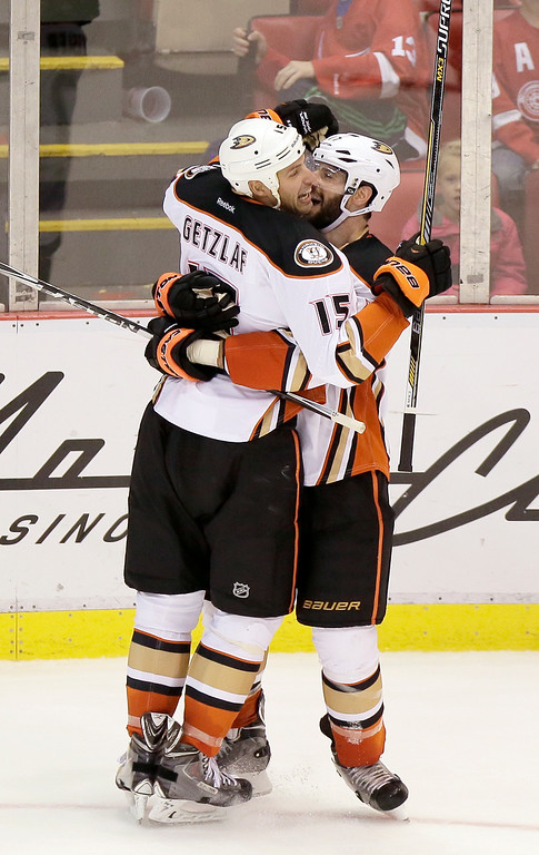 . Anaheim Ducks\' Ryan Getzlaf (15) celebrates his game-winning goal with teammate Ryan Kesler (17) during the third period of an NHL hockey game, Saturday, Oct. 11, 2014, in Detroit. The Ducks defeated the Red Wings 3-2. (AP Photo/Duane Burleson)