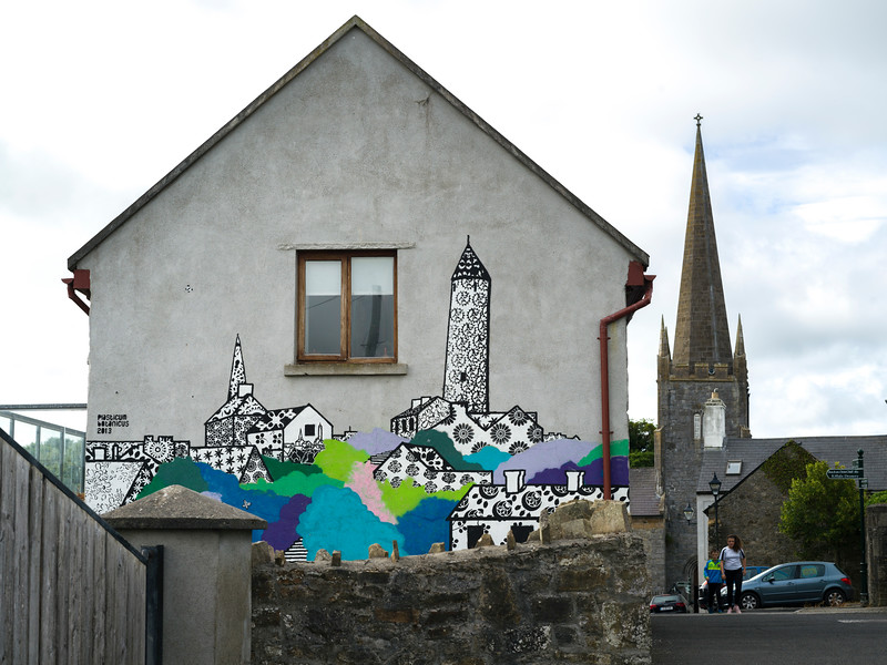 Illustration painted on wall of a house with St Patrick's Cathedral in the background, Killala Town, Killala, County Mayo, Republic of Ireland